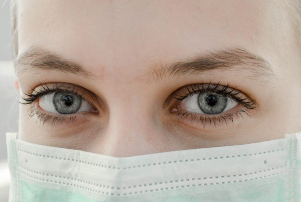 closeup photo of woman's eye wearing mask